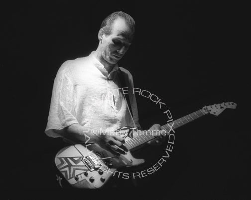 Photo of Adrian Belew of King Crimson in concert in 1984 by Marty Temme