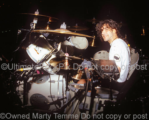 Photo of Charlie Benante of Anthrax in concert in 1991 by Marty Temme
