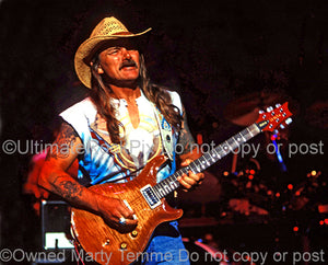 Photo of Dickey Betts of The Allman Brothers playing a PRS guitar in concert in 1994 by Marty Temme