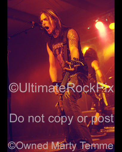 Photo of Matt Tuck of Bullet for My Valentine in concert in 2006 by Marty Temme