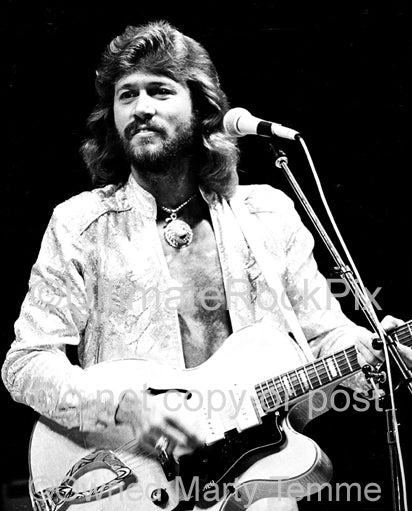 Photo of Barry Gibb of The Bee Gees in concert in 1979 by Marty Temme