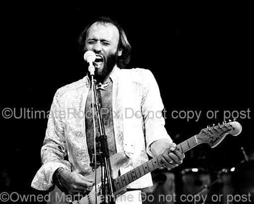 Photo of Maurice Gibb of The Bee Gees in concert in 1979 by Marty Temme