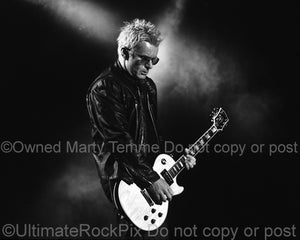 Black and white photo of Billy Duffy playing his Les Paul in concert by Marty Temme