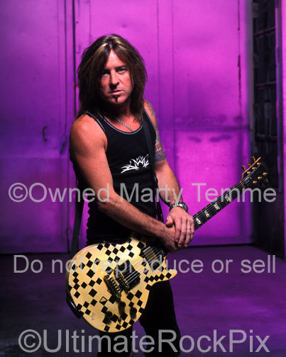 Photo of guitarist Jeff Bland of Slaughter during a photo shoot in 2003 by Marty Temme