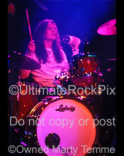 Photo of drummer Blas Elias of Slaughter in concert in Hollywood, California in 2005 by Marty Temme
