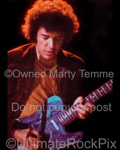 Photo of guitar player Mike Bloomfield of The Electric Flag playing a Fender Telecaster in concert in 1973 by Marty Temme