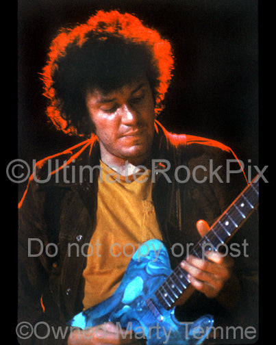 Photo of guitarist Mike Bloomfield playing a Telecaster in concert in 1973 by Marty Temme