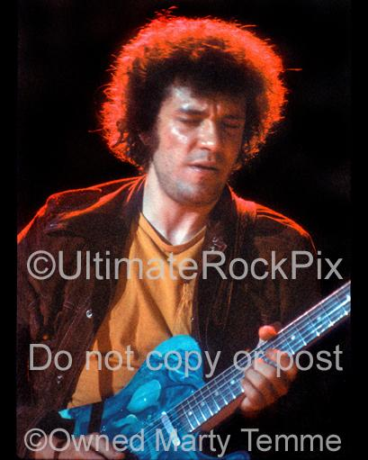 Photo of Mike Bloomfield of The Electric Flag playing a Fender Telecaster in concert in 1973 by Marty Temme