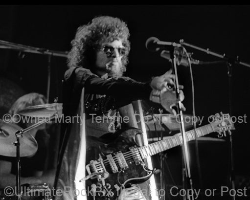 Photo of Eric Bloom of Blue Oyster Cult in concert in 1974 by Marty Temme