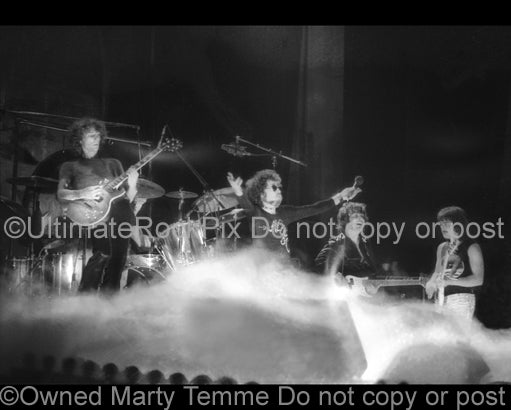 Photo of Allen Lanier and Buck Dharma of Blue Oyster Cult in concert in 1974 by Marty Temme