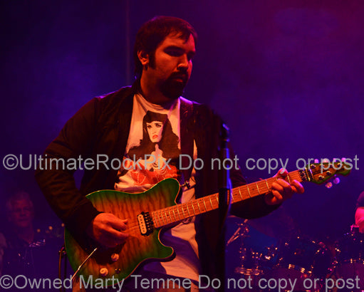 Photo of guitarist Richie Castellano of Blue Oyster Cult in concert in 2013 by Marty Temme
