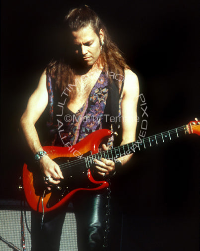 Photo of guitarist Ian Hatton of Bonham in concert in 1992 by Marty Temme