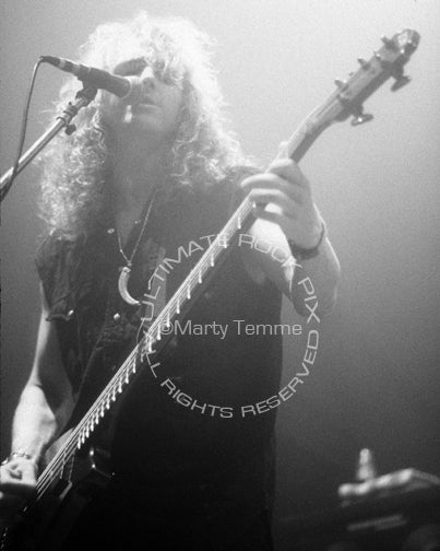 Photo of bassist John Smithson of Bonham in concert in 1992 by Marty Temme