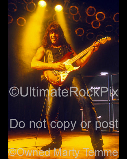 Photo of Richie Sambora of Bon Jovi in concert in 1992 by Marty Temme