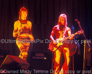 Photo of David Bowie and Mick Ronson in concert in 1973 by Marty Temme