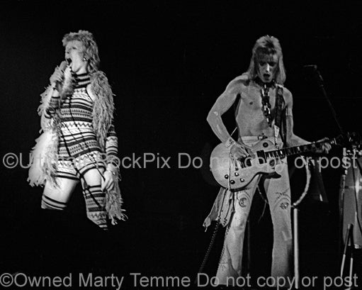 Photo of David Bowie and Mick Ronson onstage in 1973 by Marty Temme