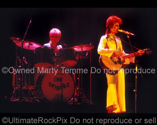 Photo of David Bowie and Woody Woodmansey onstage in 1973 by Marty Temme
