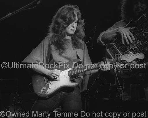 Black and White Photo of Guitar Player Bonnie Raitt Playing Slide on Her Fender Stratocaster in Concert in 1980 by Marty Temme