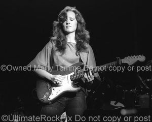 Black and White Photo of Guitarist Bonnie Raitt Playing Slide on Her Fender Stratocaster in Concert in 1980 by Marty Temme