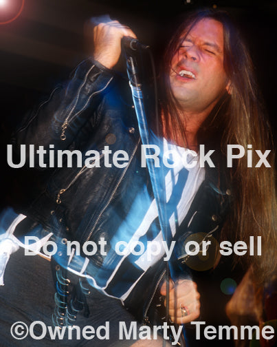 Photo of Bruce Dickinson of Iron Maiden performing in concert in 1994 by Marty Temme