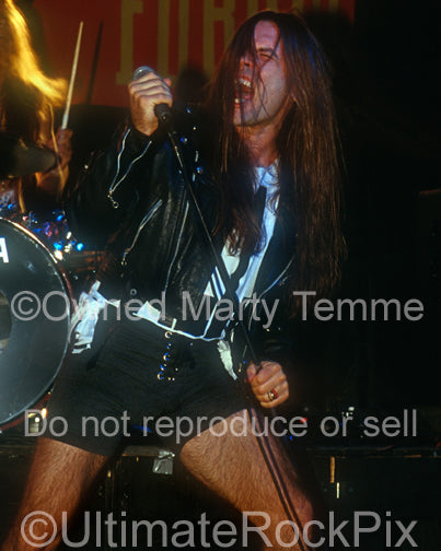 Photo of Bruce Dickinson of Iron Maiden performing onstage in 1994 by Marty Temme