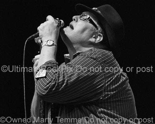 Photo of John Popper of Blues Traveler in concert in 2009 by Marty Temme
