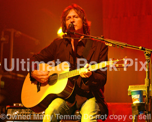 Photo of Brett Tuggle of Fleetwood Mac playing acoustic guitar in concert in 2007 by Marty Temme