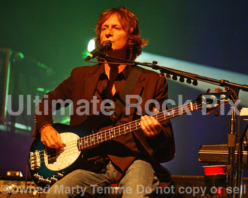 Photo of Brett Tuggle of Fleetwood Mac playing bass in concert in 2007 by Marty Temme