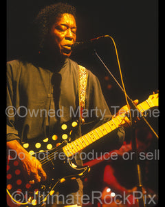 Photo of guitarist Buddy Guy playing a Fender Stratocaster in concert by Marty Temme