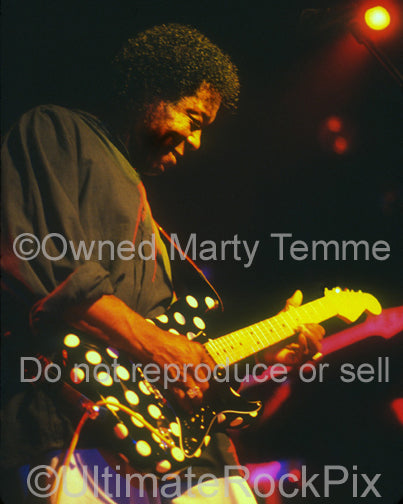 Photo of Buddy Guy playing a polkadot Stratocaster in concert