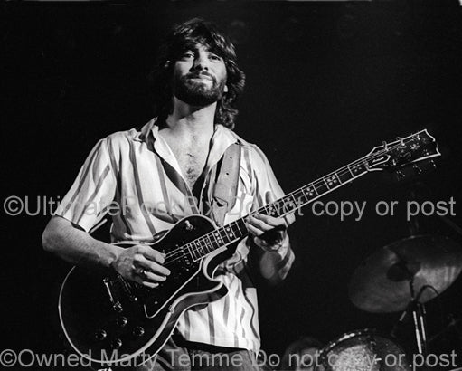 Photo of guitar player Todd Sharp of Bob Welch in concert in 1978 by Marty Temme