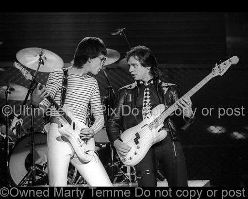Photo of Elliott Easton and Benjamin Orr of The Cars in concert in 1978 by Marty Temme