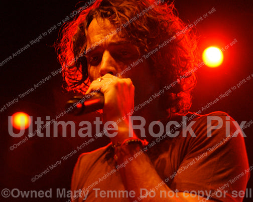 Photo of Chris Cornell performing in concert in 2008 by Marty Temme