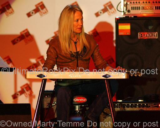 Photo of steel guitar player Cindy Cashdollar in concert in 2008 by Marty Temme