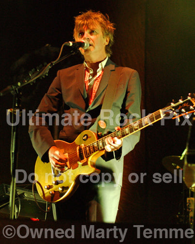 Photo of Neil Finn of Crowded House playing a Gibson Goldtop in concert by Marty Temme