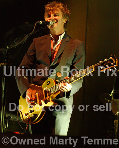 Photo of Neil Finn of Crowded House playing a Les Paul in concert in 2007 by Marty Temme