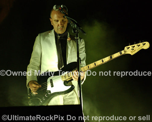 Photo of Nick Seymour of Crowded House playing a Fender Jazz Bass in concert in 2007 by Marty Temme