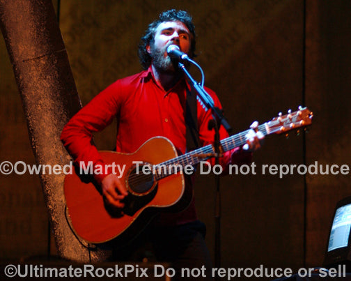 Photo of Liam Finn of Crowded House playing acoustic guitar in concert in 2007 by Marty Temme