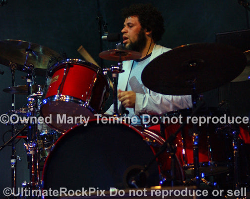 Photo of drummer Matt Sherrod of Crowded House in concert by Marty Temme