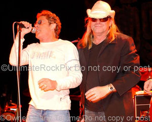 Photos of Roger Daltrey of The Who and Robin Zander of Cheap Trick Performing Together in Concert by Marty Temme