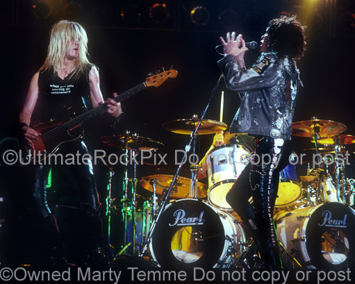 Photo of Tom Keifer and Eric Brittingham of Cinderella in concert in 1989 by Marty Temme