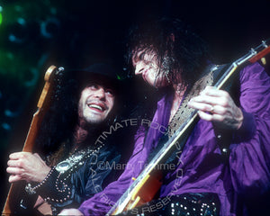Photo of Tom Keifer and Jeff LaBar of Cinderella in concert in 1989 by Marty Temme