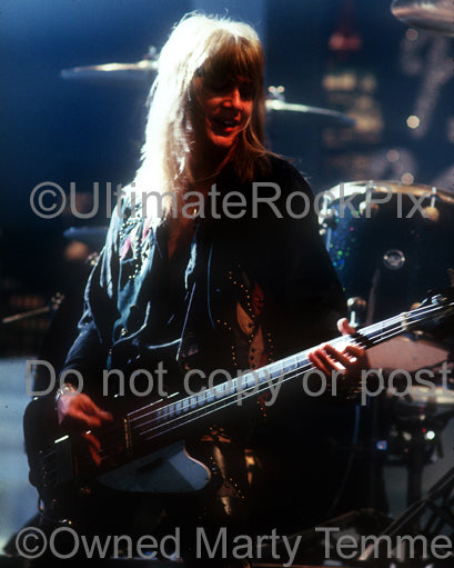 Photo of Eric Brittingham of Cinderella performing onstage in 1990 by Marty Temme