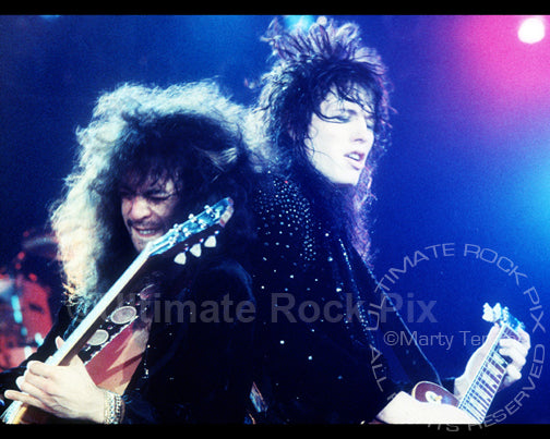 Photo of Tom Keifer and Jeff LaBar of Cinderella in concert in 1989