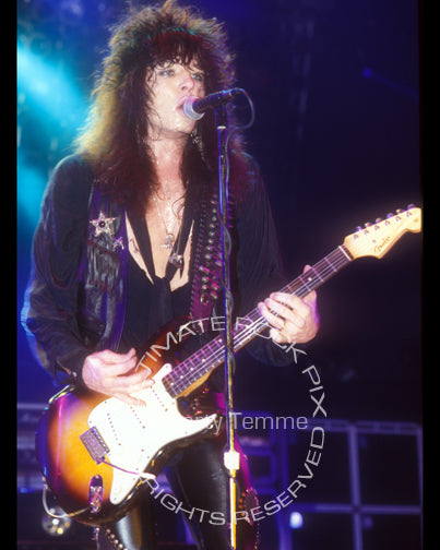 Photo of Tom Keifer of Cinderella playing a Stratocaster in concert in 1989 by Marty Temme