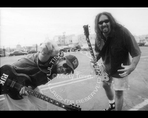 Black and white photo of Pepper Keenan and Woody Weatherman of Corrosion of Conformity during a photo shoot in 1997 by Marty Temme