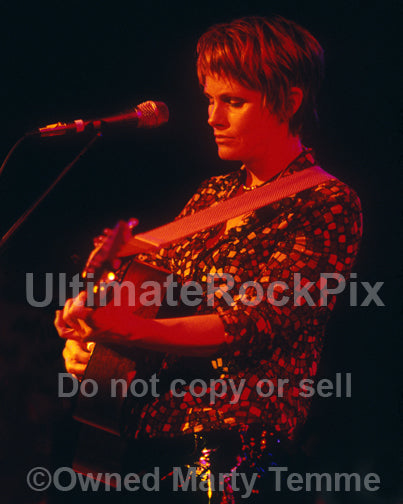 Photo of Shawn Colvin playing a Martin guitar in concert by Marty Temme