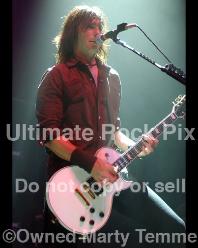 Photo of Damon Johnson of Alice Cooper, Thin Lizzy and Black Star Riders in concert in 2006 by Marty Temme