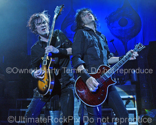 Photo of Keri Kelli and Damon Johnson of Alice Cooper in concert in 2006 by Marty Temme
