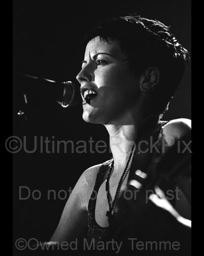 Black and white photo of singer Dolores O'Riordan of The Cranberries in concert by Marty Temme